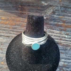Sterling Silver wrap ring with small blue stone.